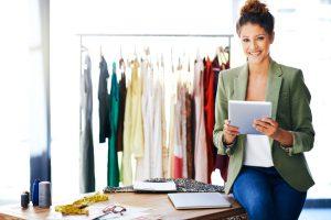 Shot of a fashion designer using her digital tablet at work
